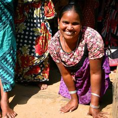 Sabitri was born without working legs & carries herself on her arms. A Kiva loan helped her increase her income x3!