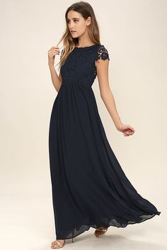 Celebrate your timeless beauty in The Greatest Navy Blue Lace Maxi Dress! Stunning floral lace overlays a princess seamed bodice with sheer cap sleeves and a backless design (with top button). A cascading, full maxi skirt flows from a fitted waist. Hidden back zipper/hook clasp.