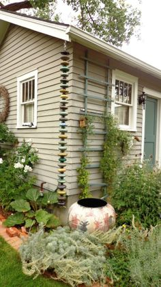 5 Reasons Rain Chains Are More Interesting Than Downspouts | Gutters & Guards, Inc.
