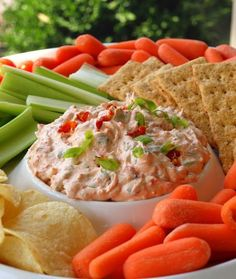 Sun-dried Tomato Dip    This dip is elegant summer party food. Think picnic, entertaining on the patio, outdoor concert on the grass, white wine, grown-ups, etc.  I had it for the first time at a party at my friend Lisa's house a few weeks ago. Let's just say, if an empty bowl is the sign of a good dish, this one's a sure winner -- it was the first thing gone from th