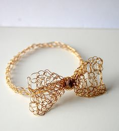Gold Easy Crocher Bow Bracelet. I've never tried anything with wire. May be cool.
