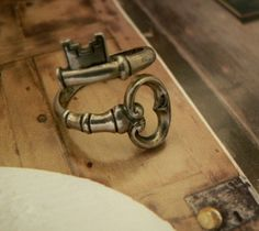 Old key bent into a ring