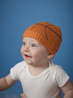 eb0b7255750 This sporty knit cap from Mud Pie features black basketball stitching for  the newest team player in your life. Part of Mud Pie s All Boy collection.