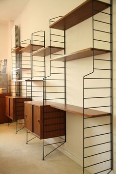 Anonymous; Teak and Enameled Metal Wall Unit by Brianco, 1960s.