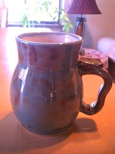 (Luna Pottery) Generous size, iron luster mug. For sale at Teller Street Gallery. $18.00