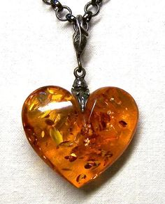 Baltic Amber Carved Heart Gunmetal Rollo Chain by ShesSoWitte, $50.00