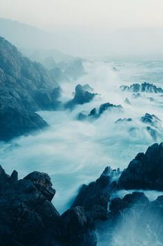 The Pacific Ocean coastline, with waves crashing against the shore. by Mint Images on 500px