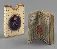 Etui and almanac of 1790.  étui of ivory, covered entirely with pique point, with plain gold edges shaped at the top to allow removal of almanac. Mounted on one side with a cameo of George III in an oval frame and on the other with a crown above a CR cypher.
