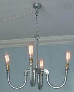 Industrial candelabra with upwards configuration and filament bulbs. £339