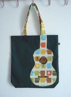 Green tote bag with appliqué ukulele in Metro Cafe fabric