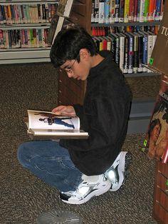 Boy reading at Tully Branch by San José Library, via Flickr