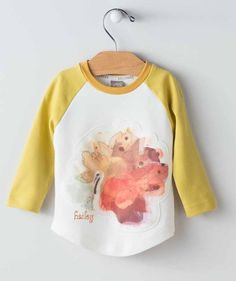 This baby shirt is bold and colorful and a perfect Thanksgiving holiday-themed top your toddler or baby girl will love! It's got a bit of retro cool to it with this handcrafted design from one of our studio artists placed on the front of this baseball tee style shirt. It goes great with so many of our fall collections but it will only be on sale here for a limited time. When it's time for this turkey to go, it won't be coming back!