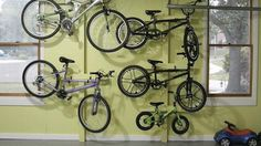 Storing bikes has always been such a pain and so unsightly. Here's a way to easily make a bike rack that gets those bikes up off the floor and onto the walls in a way that looks tidy and stream-lined, and on the cheap, too!