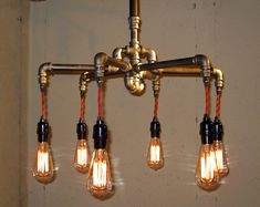 Steampunk Chandelier   Milton Douglas Lamp Co. (Could do a wall lamp so it looks like the lights are coming out of broken pipes.)