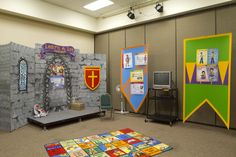 Decorating the Bible teaching area - Pre-school use one side as castle and the other as chadder area with castle turret covering TV setup...screen as window