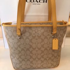 COACH NEW ZIP SHOULDER TOTE 100 % AUTHENTIC COACH NEW NEVER USED WITH TAGS SHOULDER ZIP TOTE.  WHAT A AMAZING CHEERFUL STUNNING BAG.  NEW WITH TAGS NEVER WORN AND NEVER USED.  PERFECT FOR ANY OCCASION THE BAG MEASURES 13 INCHES WIDE BY 10 INCHES TALL WITH A 9 INCH DROP ON THE HANDLE Coach Bags Shoulder Bags