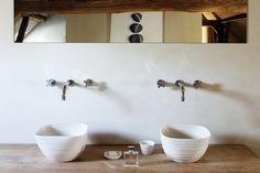 Wall mounted faucets + basins.