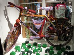 For the Utata Thursday Walk #284  Zurich, Switzerland  September 29, 2011    Found in a shop window in the old part of town, this bike was completely covered in knitted yarn. My children tell me this is the *New Graffiti* and all sorts of objects have be check us out:  http://stainlesscablerailing.com/