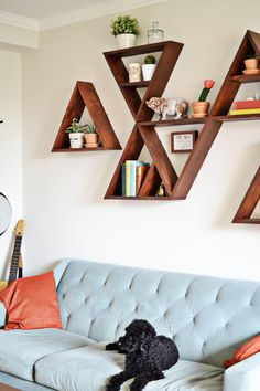 These geometric shelves look perfectly modern — and are a great eccentric backdrop to your favorite couch.