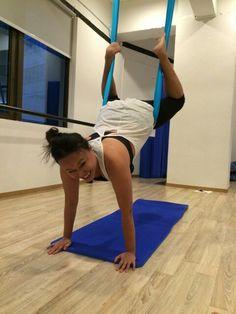 Wheelbarrow with monkey-hooked in aerial yoga