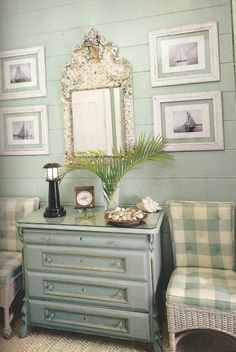 Love the style of this soft aqua paneled wall and the chair fabric/wicker, mirror, dresser color, even picture arrangement on the wall! I could duplicate this!
