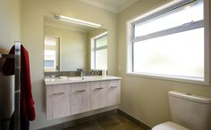 A great, easy to clean bathroom for guests. Bathroom Cleaning, Mirror, Easy, House, Furniture, Home Decor, Decoration Home, Home, Room Decor