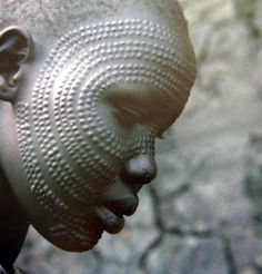 Fulani woman with facial scarification, photo by Peter Holmes