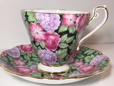 Stunning flowers dance across this dramatically beautiful teacup and saucer. Royal Standard Fine Bone China of England produced this wonderful black chintz tea cup and saucer. Measurements: The saucer is 5.75 in diameter. The cup is 3 high and 3.5 from rim to rim. This English tea