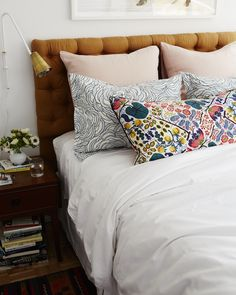 """neutral bedding, fun pillows-  from Style by Emily Henderson, """"Cup of Jo Makeover 