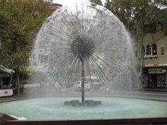 Looks like a Dandelion :) http://www.toxel.com/wp-content/uploads/2009/06/fountain04.jpg