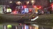 The top of a submerged car is visible in a Romeoville retention pond.