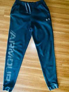 Boys size youth Large black Under Armour Joggers with draw string. Lightly worn, still in perfect condition and smoke/pet free home! Track Pants Mens, Mens Jogger Pants, Under Armour Joggers, Large Black, Cloths, Youth, Creativity, Trousers, Pajamas