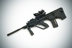 A very sexy Steyr AUG! This one has a modified lower which allows it to accept the more marketable M-16 style of magazine.