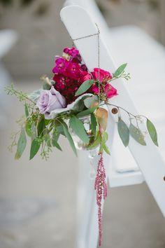 Purple, fuchsia, lavender flowers for ceremony, photo by Yazy Jo