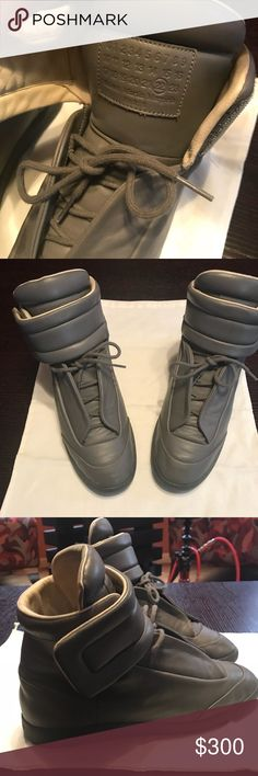 Maison Martin Margiela's Men's Fairly WELL Maintained High Top MAISON MARTIN MARGIELA Sneaker . PLEASE VERY ALL PICTURES shoe is fair shape , there is 1 sight of grotesque abrasion on the tip on right shoe but no other significant damage just normal usage signs 💯 % authentic no shoe bags nor boxes included with sell. Maison Martin Margiela Shoes Sneakers