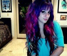 Purple/pink/black/blonde hair w/ bangs.