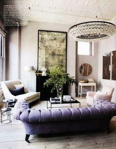 living room - chandelier - antique mirror - purple - tufting