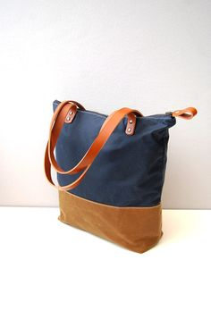 Hey, I found this really awesome Etsy listing at https://www.etsy.com/listing/166606086/navy-tan-waxed-canvas-tote-bag-with