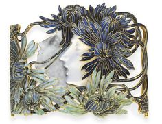 A turn of the century Lalique enamel and glass dog collar (choker) plaque entitled 'Narcisse'. The openwork on this is absolutely gorgeous.