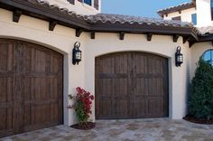 Our faux wood carriage house style garage doors add curb appeal to this Florida Mediterranean style home. Similar to Clopay Canyon Ridge & Ackue Fatezzi faux wood garage doors. www.faux-wood-garage-doors.com  ~ Great pin! For Oahu architectural design visit http://ownerbuiltdesign.com
