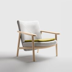The sobriety of the Paleta armchair's structure is a nod to the Scandinavian style. Available in oak and walnut, the sophisticated and extremely..