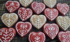 Beautiful Gingerbread Hearts with white icing decoration by CookmunkCookies on ezebee.com
