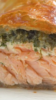 Recipe with video instructions: If you like baked salmon, you'll love this warm, herby version. Ingredients: 4 (6-8 oz) salmon fillets, skinless, 2 sheets puff pastry, 2 cups frozen spinach, thawed and squeezed to remove excess water, Egg for egg wash, Sauce:, 2 Tbsp Dijon, 2 Tbsp mayonnaise, ½ lemon, juiced, 2 tsp honey, 2 Tbsp chives, chopped, 3 Tbsp dill, chopped, 3 Tbsp parsley, chopped, 2 Tbsp tarragon, chopped