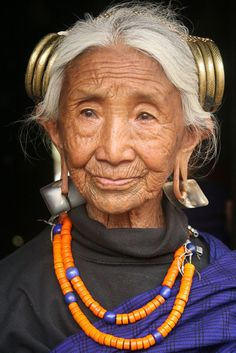 a beautiful woman, but think about this, there are a lot of trendy young people who will have ears like this in their old age.  Not such a swell look at 90.