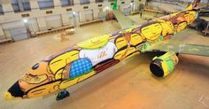 Os Gemeos Paints a Mural on a Boeing 737 with 1,200 Cans of Spray Paint for Brazil's World Cup Team  http://www.thisiscolossal.com/2014/05/os-gemeos-world-cup-plane/