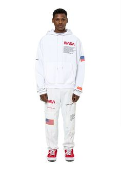 White long sleeves hooded sweatshirt inspired by Nasa. Graphic printed at front and sleeves. Red NASA embroidered at front. Model: Romeo wears size M Height: 183 cm Chest: 89 cm Waist: 73 cm Pierre Cardin, Nasa Hoodie, Metallic Jacket, Hooded Sweatshirts, Hoodies, Under Pants, Celebrity Outfits, Perfect Woman, White Hoodie