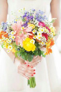 Bold Pastels...Pink Gerbera, Yellow Ranunculus, Hot Pink Spray Rose, Blue Delphinium, Orange Ranunculus, Yellow & White Chamomile Daisy....