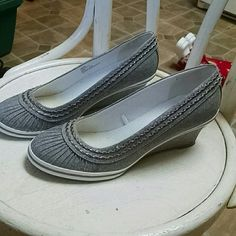 Brand new glitter grey wedges Rubber soles for non slip shoes! Tried on but never worn outside. Has soft glitter effect throughout the shoe. Has small stain on side of right shoe. Barely noticeable as shown in photo 3. Graceland  Shoes Flats & Loafers