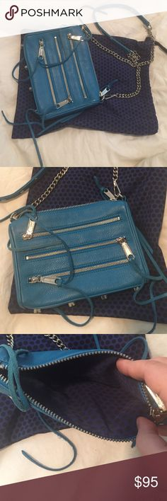 Rebecca minkoff zip bag It is mint condition. It has sat in my closet and has only been worn maybe twice! I still have the dust bag and is practically like new. Looks slightly more turquoise in person. Rebecca Minkoff Bags Crossbody Bags