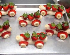 Banana strawberry cars: place small bananas in 2-3 cups of water mixed with 2Tbsp.lemon juice. Make axles of toothpicks. Place wheels as shown. Put toothpick vertically through strawberry(s) and place on top.